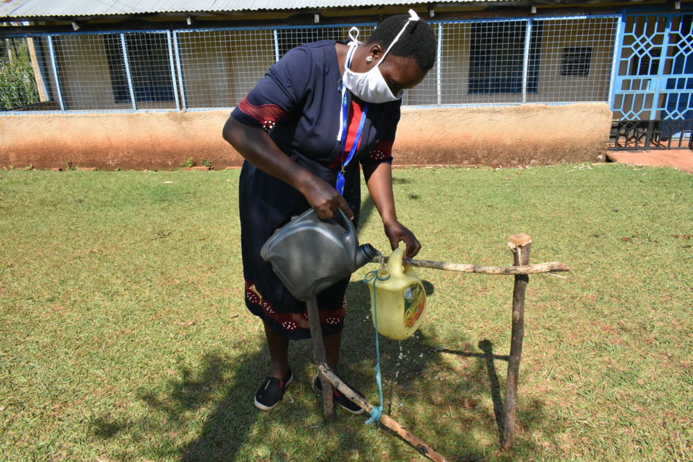 The Water Project : covid19-kenya4716-filling-handwashing-station-with-water