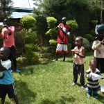 The Water Project: Nyira Community, Ondiek Spring -  Community Members Follow Handwashing Steps
