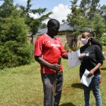 The Water Project: Nyira Community, Ondiek Spring -  Explaining Pamphlet To Participant