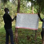 The Water Project: Nyira Community, Ondiek Spring -  Installing Reminder Chart Next To The Spring
