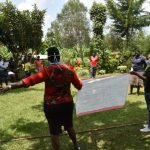 The Water Project: Nyira Community, Ondiek Spring -  Using Charts To Push Message At The Training