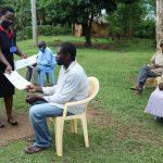 The Water Project: Murumba Community, Muyokani Spring -  Ms Betty Issuing Training Handouts