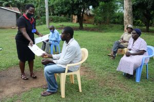 The Water Project:  Ms Betty Issuing Training Handouts