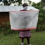 The Water Project: Murumba Community, Muyokani Spring -  Reviewing Prevention Reminders Chart