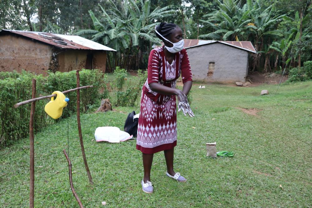 The Water Project : covid19-kenya4722-the-facilitator-teaching-the-ten-steps-of-handwashing