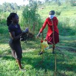The Water Project: Handidi Community, Malezi Spring -  A Lady Washing Her Hands