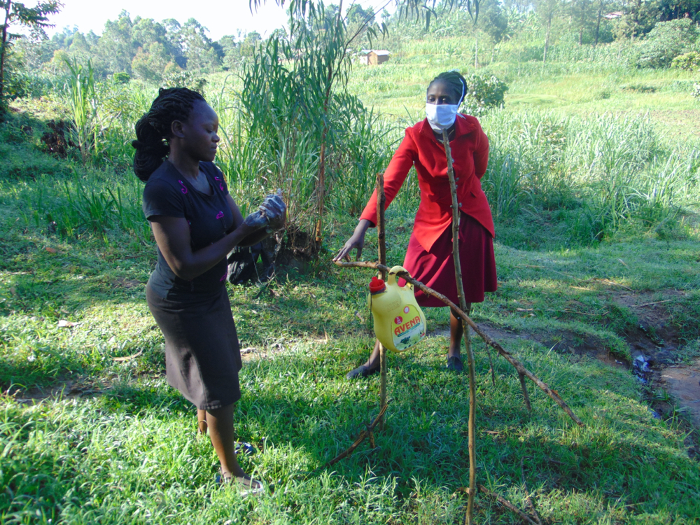 The Water Project : covid19-kenya4725-a-lady-washing-her-hands