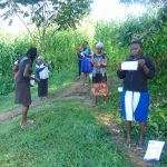 The Water Project: Handidi Community, Malezi Spring -  Community Members Armed Ready To Start Sewing