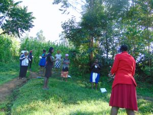 The Water Project:  Ms Wagaka Leading Mask Making Tutorial