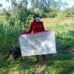 The Water Project: Handidi Community, Malezi Spring -  Training With The Aid Of The Reminder Chart