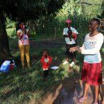 The Water Project: Bukhakunga Community, Indiatsi Omukitsa Spring -  Becky Taking Participants Through Handwashing