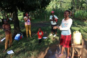 The Water Project:  Becky Taking Participants Through Handwashing