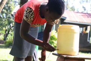 The Water Project:  Using A Setup Handwashing Point