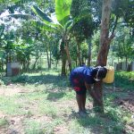 The Water Project: Ebung'ayo Community, Wycliffe Spring -  Ms Catherine Modifying The Leaky Tin Into A Tippy Tap