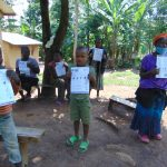 The Water Project: Ebung'ayo Community, Wycliffe Spring -  Posing For A Photo With Covid Pamphlets