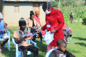 The Water Project:  Trainer Kayi Issuing Covid Informational Pamphlets