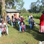 The Water Project: Shiamboko Community, Oluchinji Spring -  Trainer Kayi Leading A Session
