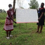 The Water Project: Mumuli Community, Shalolwa Spring -  The Facilitators Holding Up The Reminder Chart