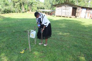 The Water Project:  Showing How To Build A Tippy Tap Handwashing Station