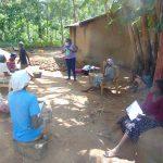 The Water Project: Handidi Community, Matunda Spring -  Ms Njeri Leads Mask Making Tutorial