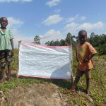 The Water Project: Mukhuyu Community, Shikhanga Spring -  Kids Pose With Installed Reminder Chart
