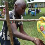 The Water Project: Ematiha Community, Ayubu Spring -  A Boy Uses The Handwashing Station