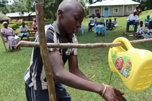 The Water Project:  A Boy Uses The Handwashing Station