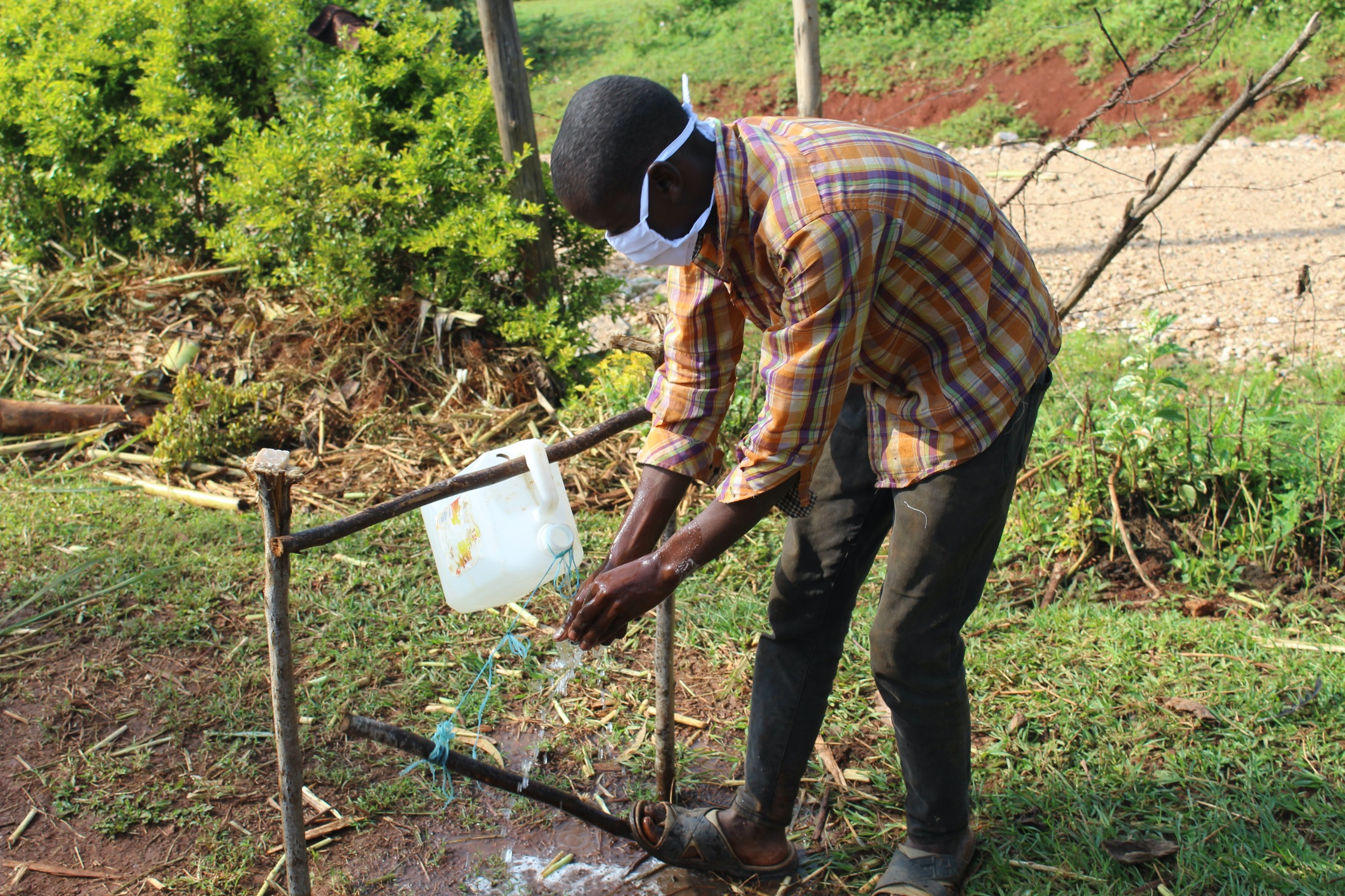 The Water Project : covid19-kenya4745-rinse-your-hands-in-clean-running-water