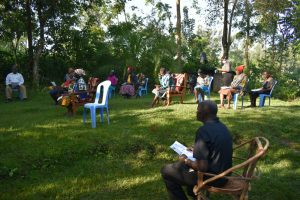 The Water Project:  Community Members Listen To The Facilitator