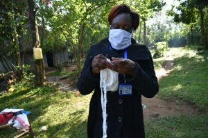 The Water Project:  The Facilitator Sewing A Mask
