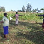 The Water Project: Emusanda Community, Walusia Spring -  Ensuring The Social Distance Of Two Meters Is Kept
