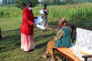 The Water Project:  Ms Kayi Issuing Informational Pamphlets On Covid