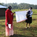 The Water Project: Emusanda Community, Walusia Spring -  The Facilitators Holding Up The Teaching Aid