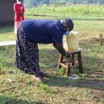 The Water Project: Emusanda Community, Walusia Spring -  Rinse Hands In Clean Running Water