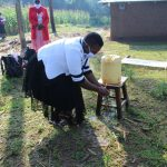 The Water Project: Emusanda Community, Walusia Spring -  Use Running Water To Rinse Your Hands