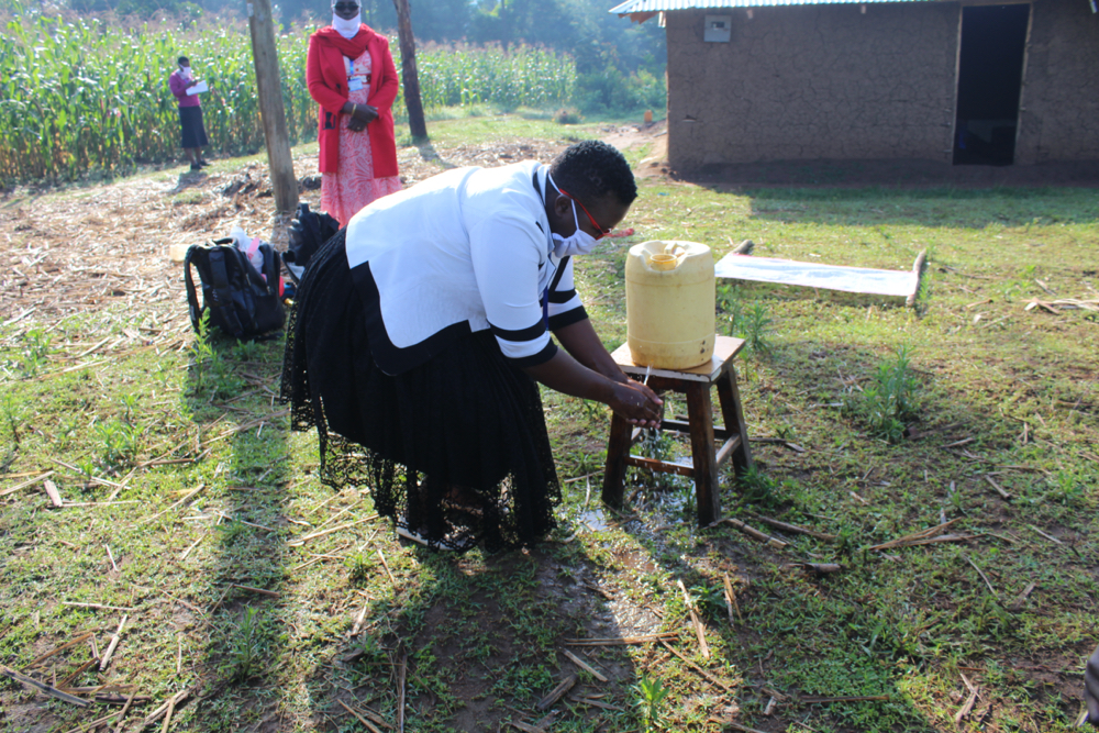 The Water Project : covid19-kenya4753-use-running-water-to-rinse-your-hands