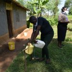The Water Project: Shikoti Community, Amboka Spring -  Ms Stella Filling The Container With Water