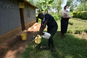 The Water Project:  Ms Stella Filling The Container With Water