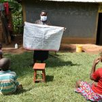 The Water Project: Shikoti Community, Amboka Spring -  Reviewing The Prevention Reminders Chart