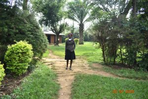 The Water Project:  Mercy Ogonga Outside Her Home