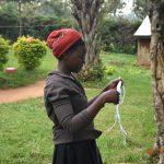 The Water Project: Eshiakhulo Community, Asman Sumba Spring -  Mercy Ogonga Putting On A Mask