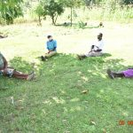 The Water Project: Ataku Community, Ngache Spring -  Catherine And Others Observe Social Distancing At Training