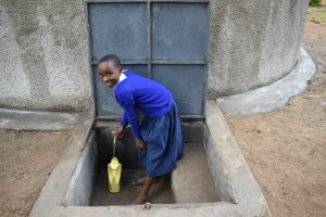 The Water Project:  Student Collecting Water