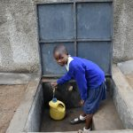 The Water Project: Mutiva Primary School -  Student Collecting Water