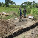 The Water Project: Mahira Community, Litinyi Spring -  Women Deliver Materials Next To Spring Drainage Channel