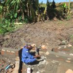 The Water Project: Mahira Community, Litinyi Spring -  Pipe Setting