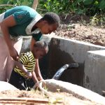 The Water Project: Mahira Community, Litinyi Spring -  Like Mother Like Son
