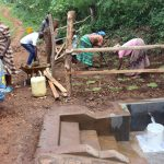 The Water Project: Harambee Community, Elijah Kwalanda Spring -  Grass Planting
