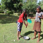 The Water Project: Harambee Community, Elijah Kwalanda Spring -  Demonstrating Handwashing