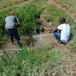 The Water Project: Mukhuyu Community, Chisombe Spring -  Artisan Taking Site Measurements